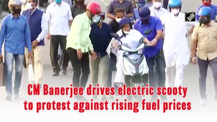 Bengal CM Banerjee drives electric scooty to protest against rising fuel prices