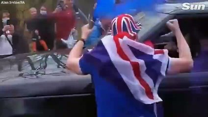 Rangers fans celebrate in George Square, Glasgow after Scottish Premiership title win