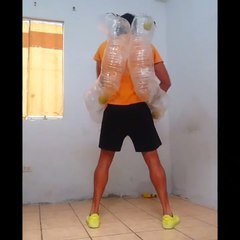 Guy Wearing Two Plastic Pipes on Back Performs Trick With Balls
