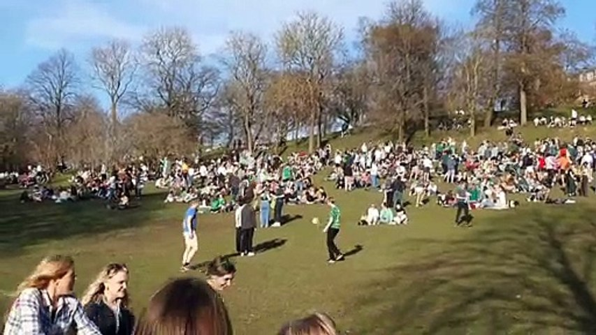 Hundreds of people gather in Kelvingrove Park for St Patrick's Day 2021