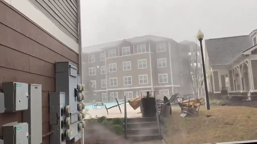Powerful Thunderstorm Winds Blow Away Poolside Furniture in Starkville, Mississippi
