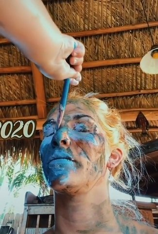 Little Girl Paints her Mom's Face With Blue Color
