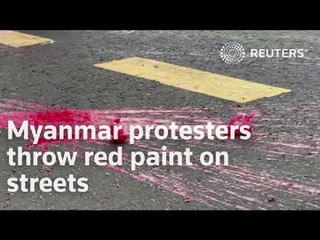 Myanmar protesters throw red paint on streets