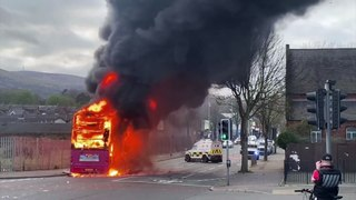 Rioters set bus alight in Belfast after days of disorder in Northern Ireland