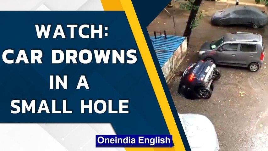 Mumbai: A car drowns into a little hole in the Ghatkopar district   Watch   Oneindia News