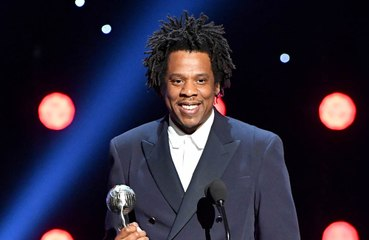 Why is Jay-Z suing a photographer?