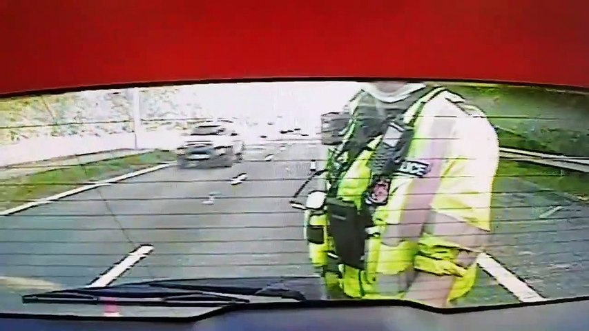 Watch as motorway driver narrowly misses West Yorkshire Police officer (Video: WYP)
