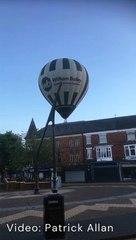 Hot air balloon crashes into town centre