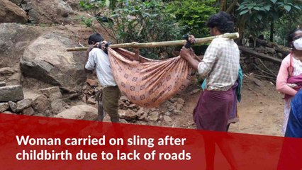 Woman bleeding after childbirth carried on sling to ambulance due to lack of roads