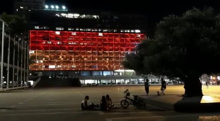 The Tel Aviv Municipality building lit up with the German flag  (Credit: Tel Aviv Municipality)