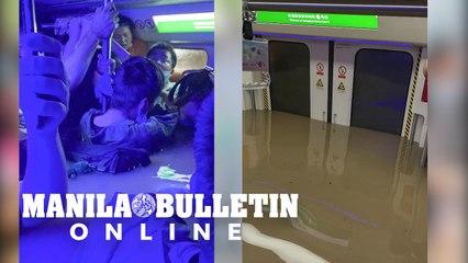 Severe rainstorms kill 12 in flooded China subway