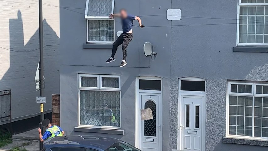 Shocking moment man falls from roof while evading police during cannabis raid