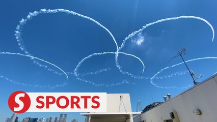 Japan's air force team flies over Tokyo Olympic Stadium