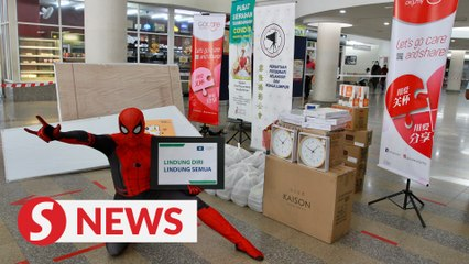 Spider-Man returns with food packets and stationery items at Ampang Hospital