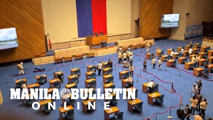 Lower house personnel conduct final disinfection of plenary hall prior SONA