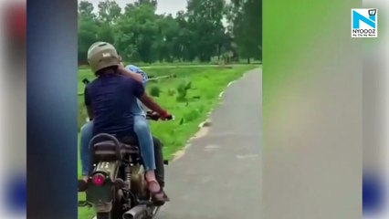 Oops! Couple romances on a moving bullet, caught by villagers