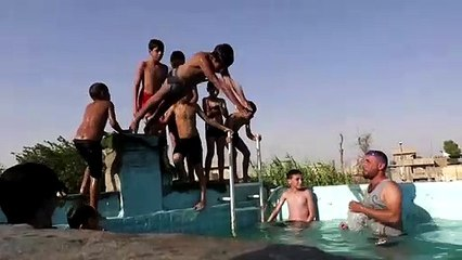 Mosul resident offers swimming lessons in makeshift pool