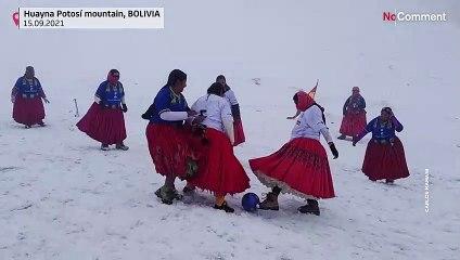 Bolivian Cholitas play football at top of a mountain