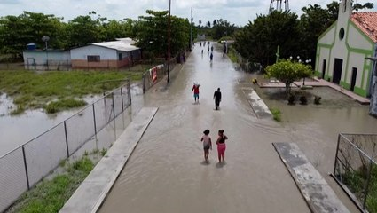 Venezuelan villagers try to salvage their livelihoods after severe floods