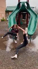 Two Women Speed Down Slide Together and Fall Hard on Their Butts