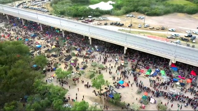 Drone videos show thousands of Haitian migrants trying to enter the US