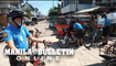 Cops on bikes issue tickets to erring residents for not wearing facemask in Isla Verde in Davao City