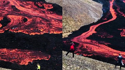 'Tourists in awe of magnificent lava flowing from Fagradalsfjall Volcano'