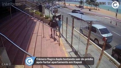 Câmera flagra dupla tentando sair de prédio após furtar apartamento em Itapuã