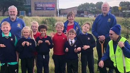 Larkholme Primary School plant trees and flowers in their own orchard