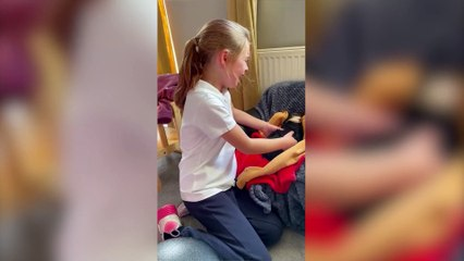 Adorable moment a young girl burst into tears of joy after coming home to her new puppy.