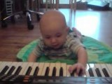 baby nephew being cute on piano