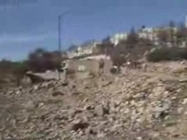 Israeli Terrorist Settler Shooting Palestinians in Hebron