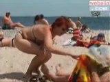 Camara oculta exitado en la playa