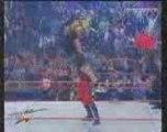 Kane returns (saves Undertaker & The Rock)