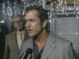 Mel Gibson shows off new girlfriend at Wolverine premiere